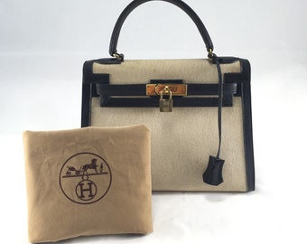 Black Leather and Toile Kelly Bag HERMÈS, 1973