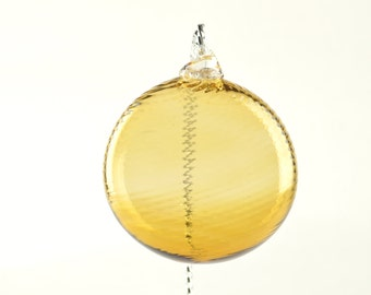 Hand Blown Flatened Glass Ornament soft bronze color (with swirls)