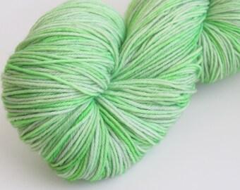 "Hand dyed sock yarn in ""Honeydew"" colorway"