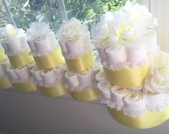 Baby Shower Diaper Cake Centerpiece Decorations.  Give the gift of diapers while decorating for the baby shower!