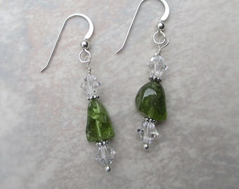 Green peridot earrings with clear Swarovski crystals and sterling silver spacer beads on a sterling silver ear wire