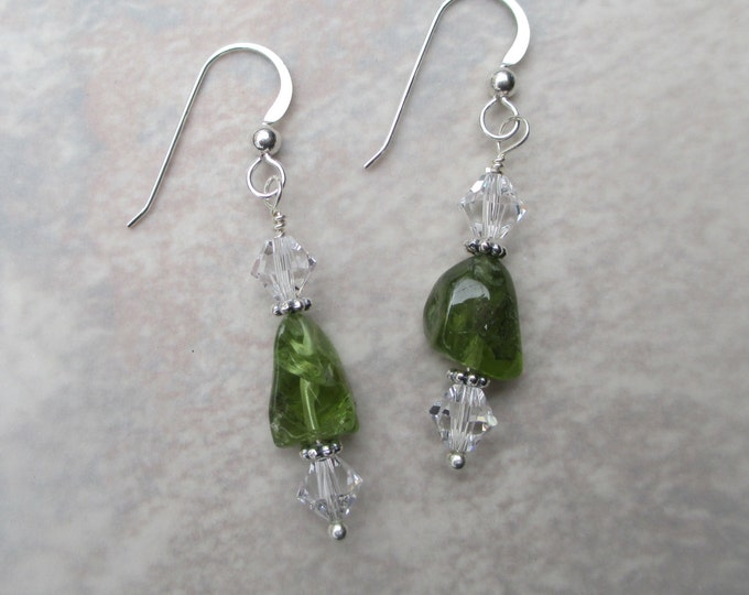 handmade green peridot earrings with clear Swarovski crystals and sterling silver spacer beads on a sterling silver ear wire