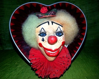 Hand made doll. Portrait of clown at heart