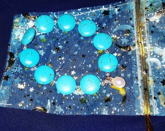 Stunning semi precious turquoise, sterling silver and pearl charm bracelet