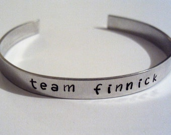 The Hunger Games inspired, your choice of team cuff bracelet