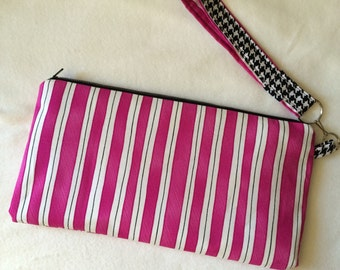 Pink and black lined zipper pouch