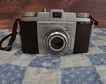 Vintage Kodak Pony 135 35MM Camera with strap 1960s retro collectible shelf home decor