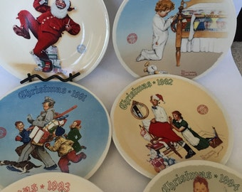 Norman Rockwell Christmas collectible plate set of 6 including 1989, 1990, 1991, 1992, 1993, 1994 Price is 7.77 EA