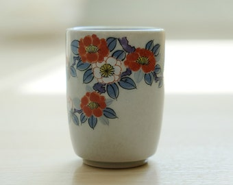 Japanese Celadon tea mug with hand-painted sakura flower detail, matcha, stoneware
