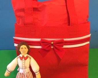 Red gift bag and Clara Barton doll