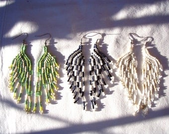 Asymmetrical earrings in beads made in Bali