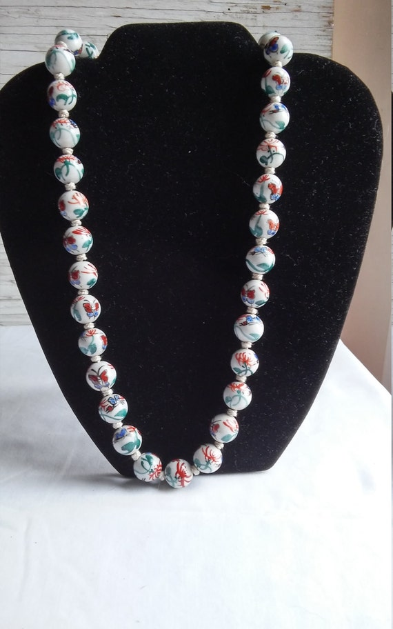 """Beautiful Handmade, Hand Knotted 24"""" Glass Beaded Necklace. Each bead separated by a knot. 37 beads total. Each glass bead 1/2"""". Butterflies"""