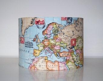 World map drum lampshade. Travel postage, vintage look.
