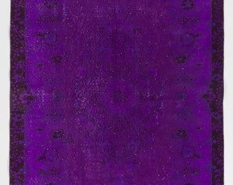 5.7x9.1 Ft Purple color OverDyed Vintage Turkish Rug. Ideal for both residential and commercial interiors. Wool & Cotton blend. Y398