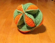 Amish Puzzle Ball. Hand Crocheted. Green and Orange