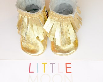 Double Fringe Leather Baby Moccasin Booties in Metallic Gold