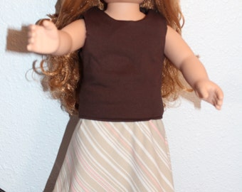 Brown top with silky skirt that is short in front and log in back