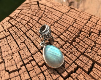 Pendant:  antiqued sterling silver clasp with pear-shaped moonstone