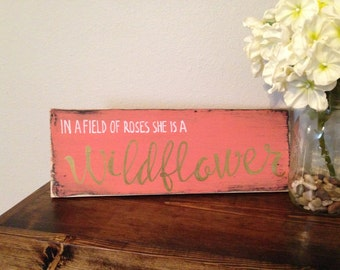 In a field of roses she is a wildflower wood sign