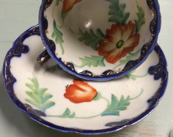 Hand painted teacup and saucer