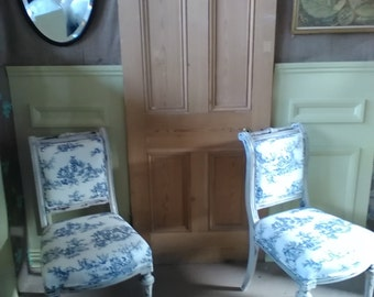 A pair of Edwardian Hall Chairs