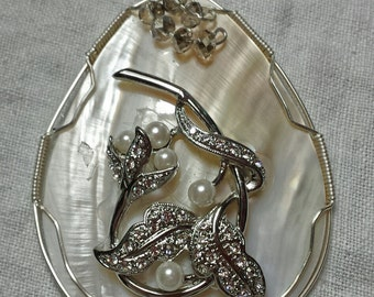 Very large pendant wire wrapped mother of pearl with vintage jewelry embellishment.