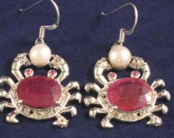 Ruby and Pearl sterling earrings.