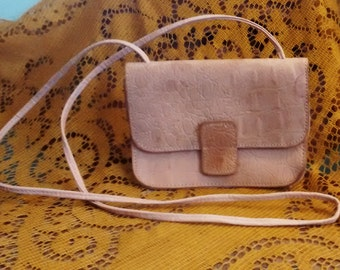 small, peach leather purse