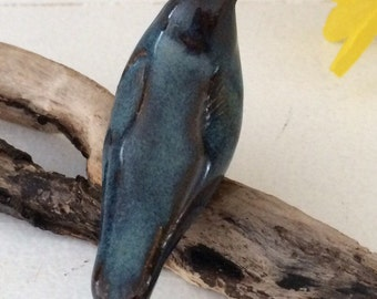 Pottery Bird on Driftwood
