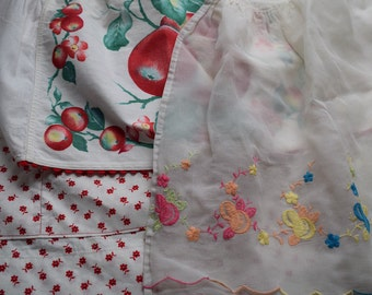 Vintage 1950s flower and fruit aprons