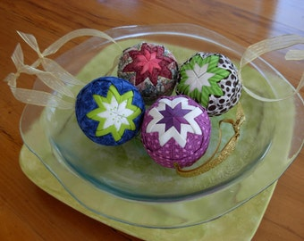 set of 4 colorful Christmas ornaments