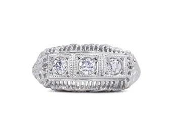 Art Deco Three Stone Diamond Filigree Ring, circa 1930, Old European Cut Diamonds ~0.42 carats, pave set with milgrain, 14K White Gold