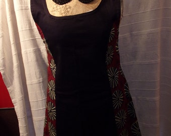 Black dress with bands of African fabrics