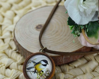 Pendant made of wood with a bird titmouse