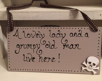 """An 8"""" x 4"""" wooden plack - A lovely lady and a grumpy old man live here"""