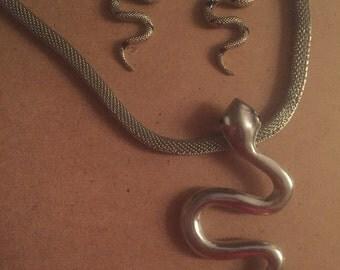 Snake charmer necklace, and snake earrings