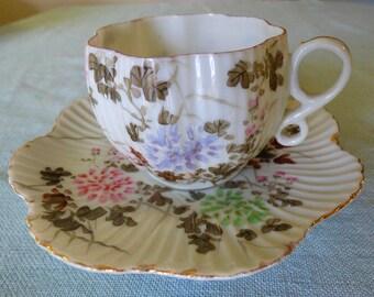 Translucent ribbed floral teacup