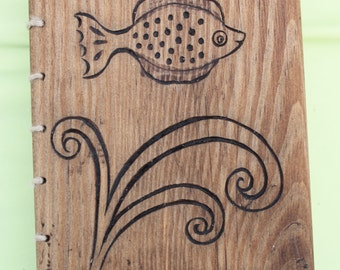 Notebook with woodcarving