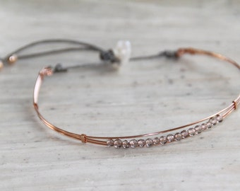 Collection Bangle Bracelet the mini plated rose gold and smoked quartz. Model filed
