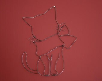 Cat in wire to hang on the wall