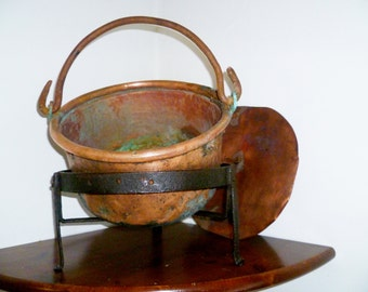 Old copper cauldron with lid