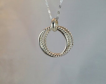 Sterling silver linked circle pendant