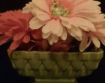 Elaborate faux flower arrangement in vintage ceramic holder