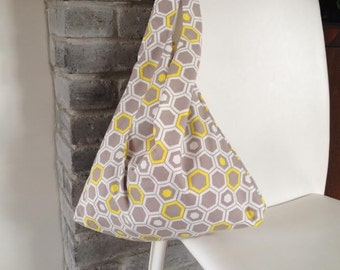 folding tote bag, reusable tote bag, market bag, shopping bag, grocery bag in yellow and gray cotton with honeycomb print