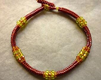 Deep red beaded bracelet with lime and barleysugar detail