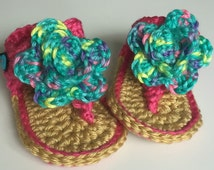 3-6 mos. girls flip flop sandals. Bright pink with teal blue flower.
