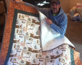 Quilt throw with nature scene.