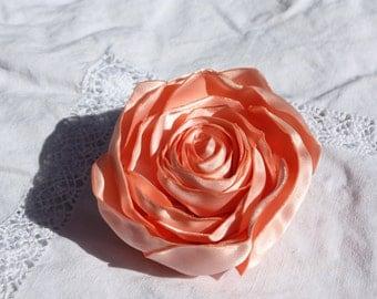 Coral / peach satin flower.