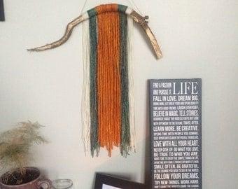 Handmade wood and wool wall hanging