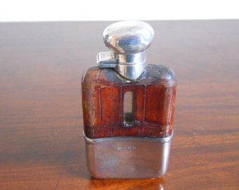 Solid silver and glass hip flask with crocodile skin cover by Hukin & Heath 1931